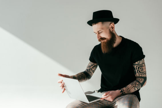 man researching laser tattoo removal side effects